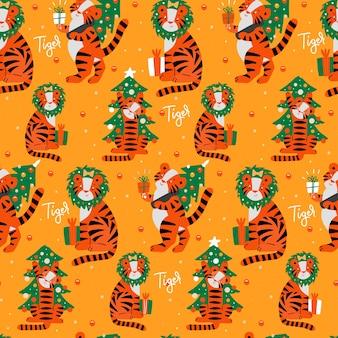 손에 호랑이 패턴의 년에 대한 원활한 패턴 크리스마스 트리와 평면 스타일 호랑이를 그립니다...