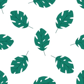 Seamless pattern of green tropical leaves vector elements on a white background in a flat style