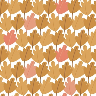 Seamless pattern of hand drawn autumn oak leaves multicolored foliage in the form of an autumn fores...