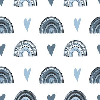 Seamless pattern of hand drawn hearts and boho rainbow in pastel blue colors