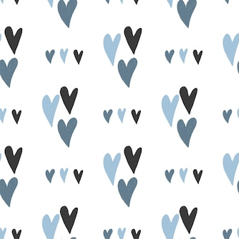 Seamless pattern of hand drawn simple hearts in pastel blue colors