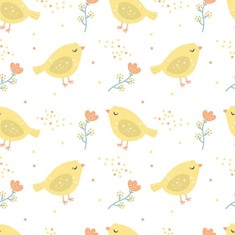黄色の鶏肉と花とシームレスなパターンハッピーイースター