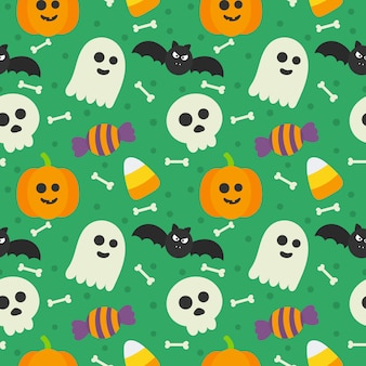 Seamless pattern happy halloween icons isolated on green.