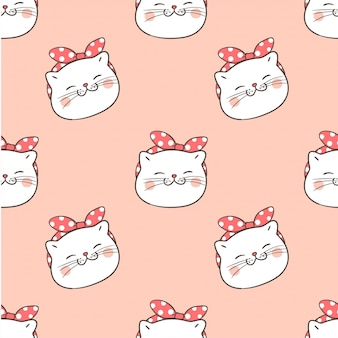 Seamless pattern head of cat on pastel.