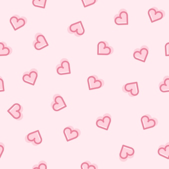 Seamless pattern of hearts on a pink background