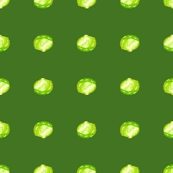 緑の背景にシームレスパターンの氷山サラダ。レタスのシンプルな飾り。