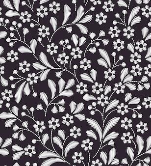 ヴィンテージスタイルのシームレスなパターン。刺繡の花。