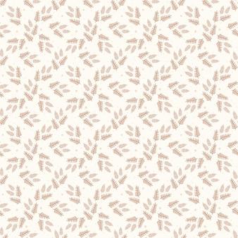 Seamless pattern of leaves twigs in warm beige colors