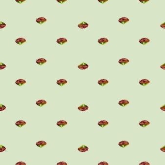 Бесшовный фон салат лола роза на пастельно-зеленом фоне. орнамент минимализм с листьями салата.