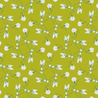 緑の背景にシームレスなパターンのマグノリア。青い花の美しい飾り。生地の幾何学的な花のテンプレート。デザインベクトルイラスト。