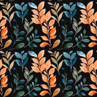 秋のシームレスなパターンは、黒の背景に水彩画を残します