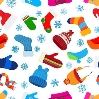 白い背景の上のフラットスタイルのクリスマス暖かい冬の服のシームレスなパターン