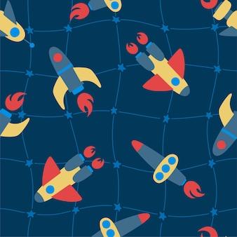 파란색 배경에 화려한 로켓의 완벽 한 패턴입니다. 별의 우주 격자입니다. 어린이 디자인, 직물, 포장, 벽지, 섬유, 가정 장식에 이상적입니다.