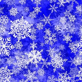 青い色の複雑なクリスマスの雪片のシームレスなパターン。雪が降る冬の背景