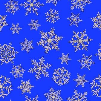 青い背景の灰色の複雑なクリスマスの雪片のシームレスなパターン