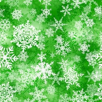 緑の色の複雑なクリスマスの雪片のシームレスなパターン。雪が降る冬の背景