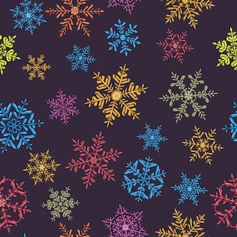 暗い背景にさまざまな色の複雑なクリスマスの雪片のシームレスなパターン