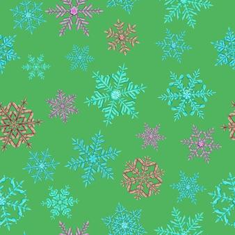 緑の背景にさまざまな色の複雑なクリスマスの雪片のシームレスなパターン