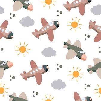 太陽と雲とかわいい飛行機のシームレスなパターン