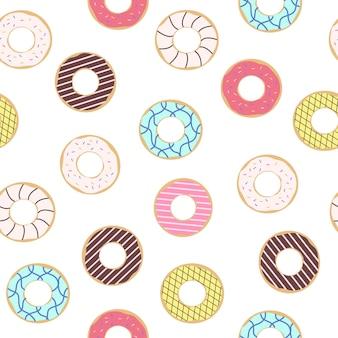Бесшовный фон из пончиков с цветной глазурью. модные красивые пончики белый фон.