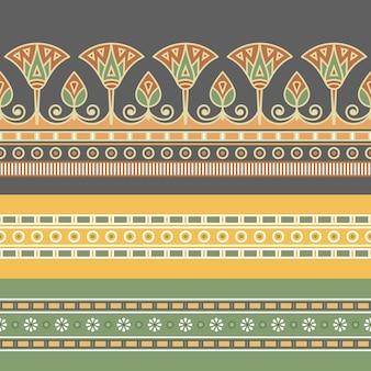 蓮の花とエジプトの飾りのシームレスなパターン。