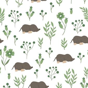 様式化された葉を持つ手描きの面白い赤ちゃんモグラのシームレスなパターン。