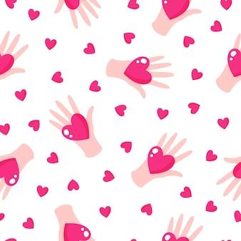 結婚式やバレンタインデーのための手と心のシームレスなパターン。