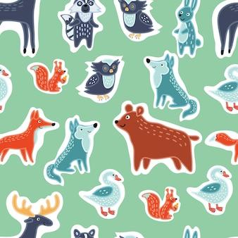 面白いかわいい動物のイラストセットのシームレスなパターン