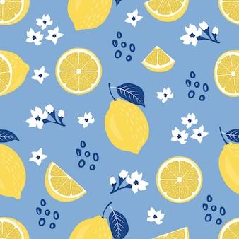 熱帯の美しい花とライムやレモンの素敵な背景のシームレスなパターン