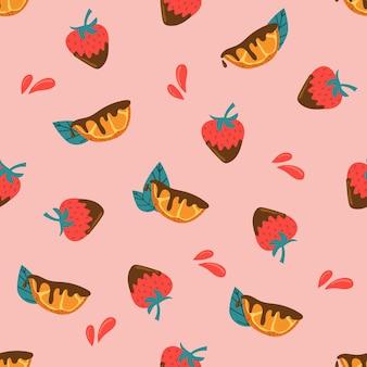 ピンクの背景にチョコレートのオレンジスライスとイチゴのシームレスなパターン