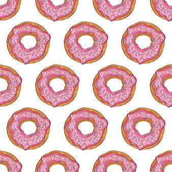 ピンクのドーナツのシームレスなパターン