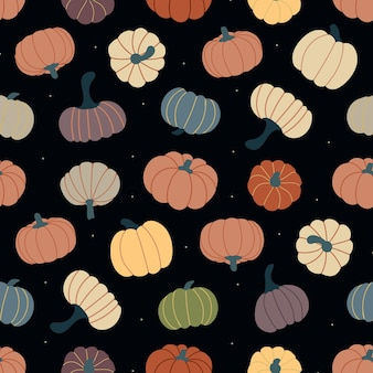 熟したカボチャと暗い背景のベクトル図上のドットのシームレスなパターン