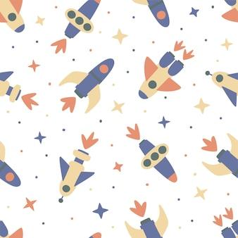 Бесшовный фон из космических кораблей и звезд на белом фоне. идеально подходит для детского дизайна, ткани, упаковки, обоев, текстиля, домашнего декора.