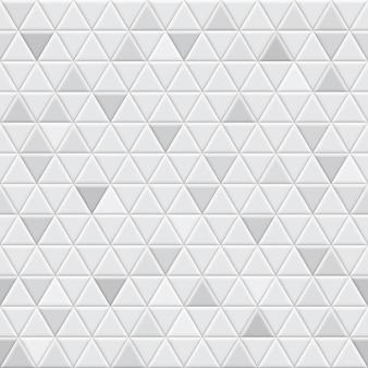 灰色の三角形のタイルのシームレスなパターン