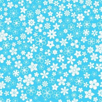 水色のさまざまな小さな花のシームレスなパターン
