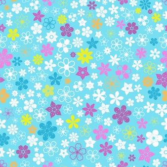 さまざまな色のさまざまな小さな花のシームレスなパターン