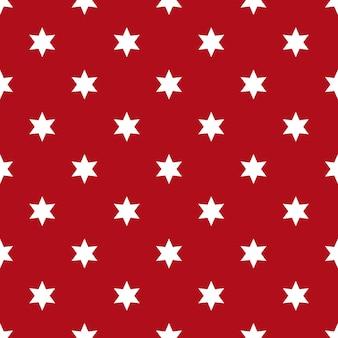 赤い背景の上の白い星のシームレスなパターン