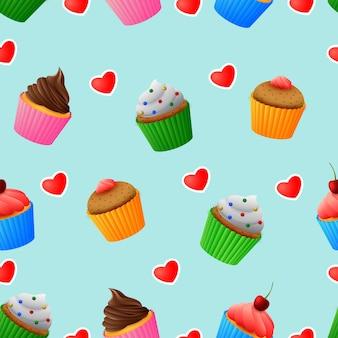 おいしい色のカップケーキのイラストのシームレスなパターン