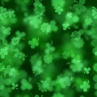 Бесшовный узор на день святого патрика из размытых листьев клевера в зеленых тонах