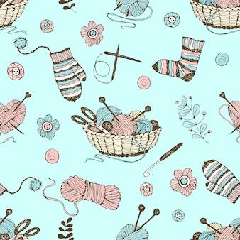バスケットと糸のボールで編み物をテーマにしたシームレスなパターン
