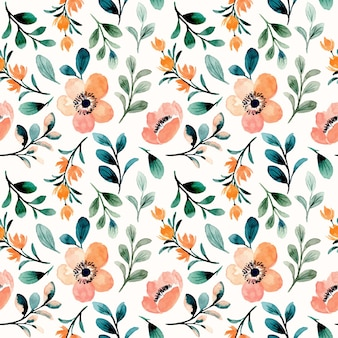 Seamless pattern of peach floral and green leaves with watercolor