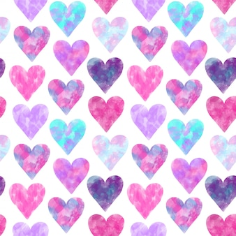 Seamless pattern of pink and purple watercolor hearts