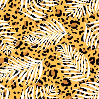 Seamless pattern of silhouettes palm leaves dypsis lutescens on the background of a leopard skin.