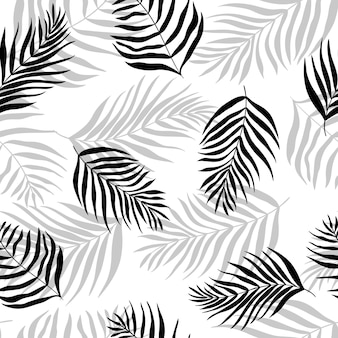 Seamless pattern of silhouettes palm leaves dypsis lutescens.