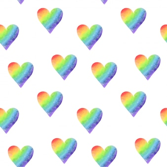 Seamless pattern of simple rainbow watercolor hearts