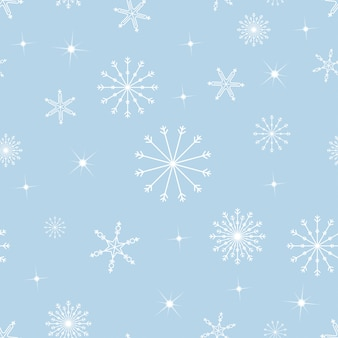 Seamless pattern snowflakes in different size on blue