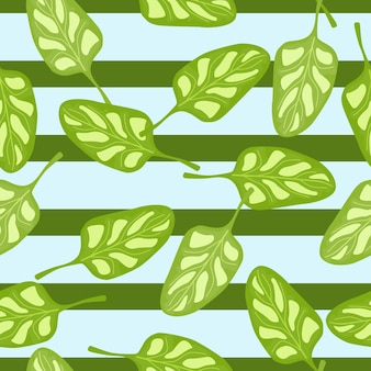 Seamless pattern spinach salad on blue striped background. modern ornament with lettuce.