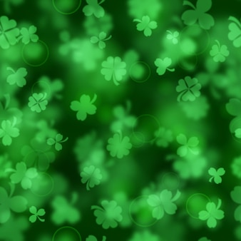 Seamless pattern on st. patrick's day made of blurry clover leaves in green colors