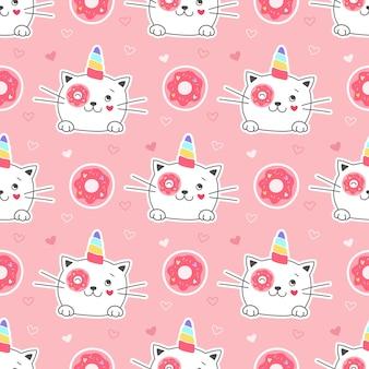 Бесшовный фон сладкий котенок единорог с пончиком. девичий принт на текстиле, упаковке, ткани, обоях.