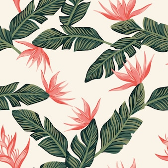 Seamless pattern wallpaper composition from dark green tropical banana leaves and flowers